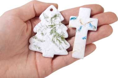 plantable memorials tree and cross shapes shown in hand for size scale