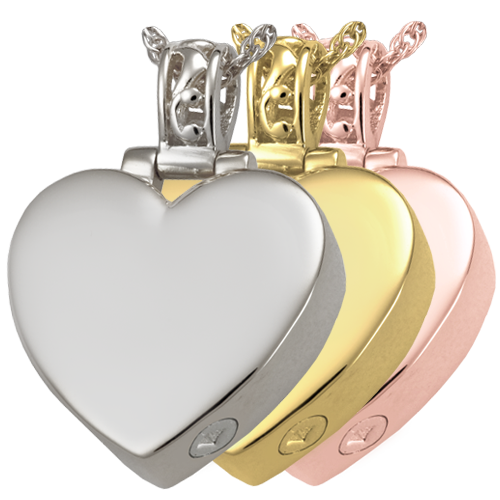 Filigree Bail Heart jewelry shown in silver and gold metal options