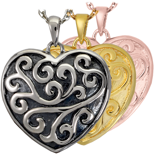 Scrollwork Filigree Heart jewelry shown in silver and gold metal options