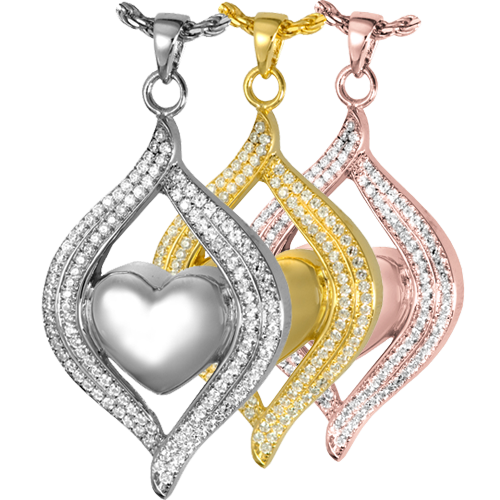 Teardrop Ribbon Heart jewelry shown in silver and gold metals