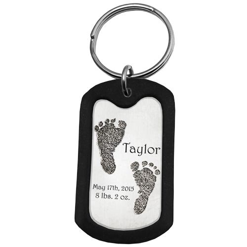 Rubber silencer shown with Stainless Steel Dog Tag 2 Footprints key fob