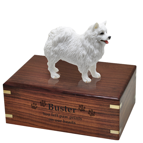 Engraving shown directly into front of American Eskimo dog figure wood urn