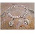 Mini oval handprint charms may used to create a charm bracelet.