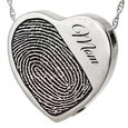 Silver heart with fingerprint and name engraved on front with chamber