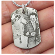 Dog Tag pendant engraved with custom photo shown in hand