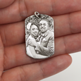 engraved photo pendant shown in hand