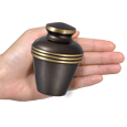Umber and Gold Banded Mini Urn shown in hand for size scale