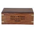 Engraving shown directly into front of wood urn